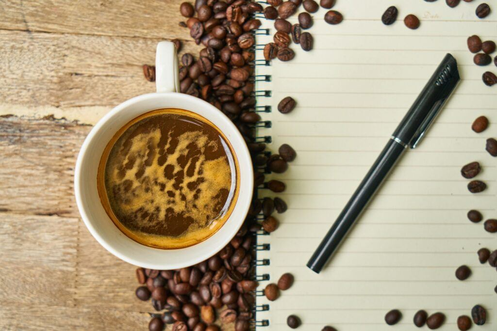 note book and coffee https://barefootaffiliatetravel.com/ used in the article Traveling Colombia 2021