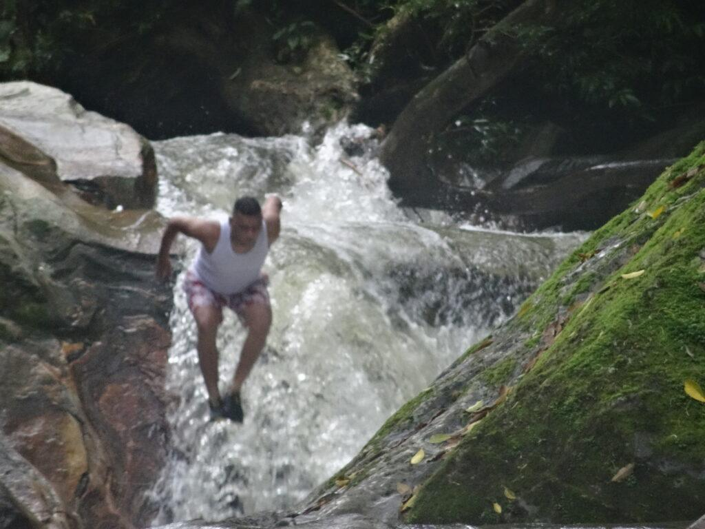 guy jumping into a creek near Minca, Colombia. South America Travel Photos and Comment Page.