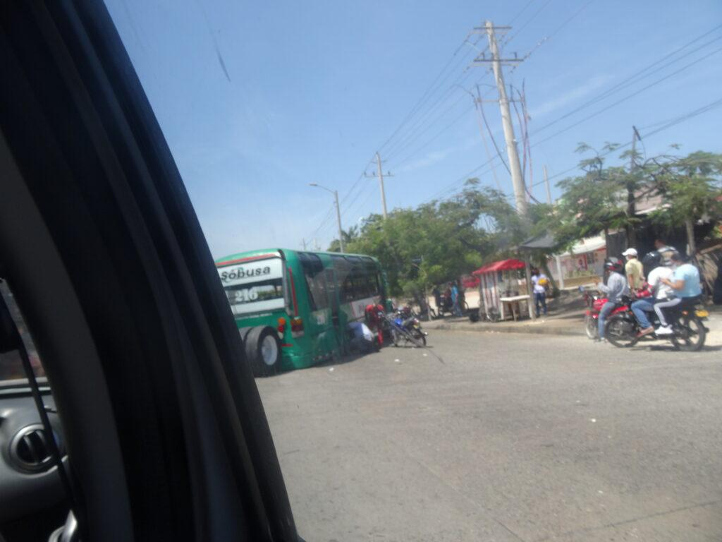 A bus without rear wheels on a street, used in the article Driving in Colombia. Things you Should Know